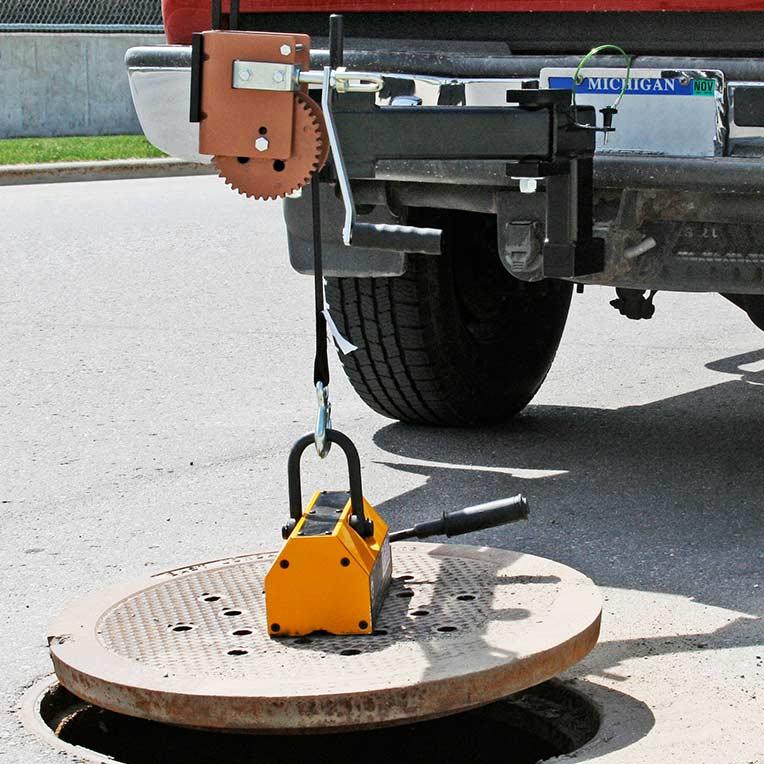 Industrial magnetics inc manhole powerarm™